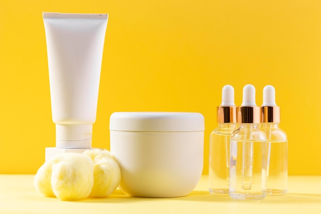 Creme containers on yellow background