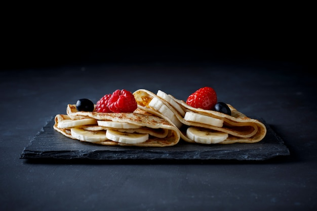 Crepe with banana, strawberry and chocolate