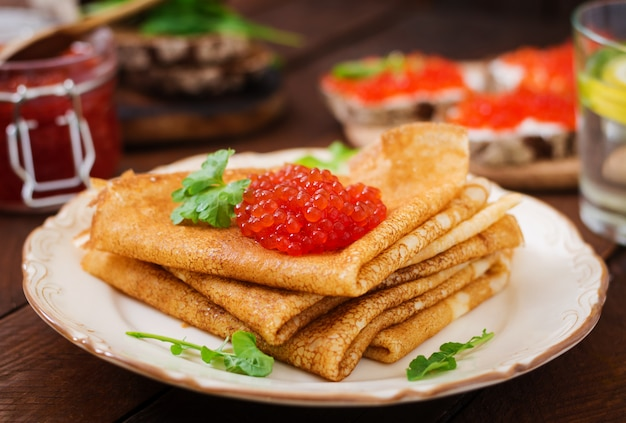 Crepes with cream cheese and red caviar