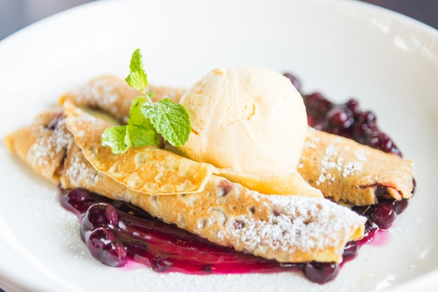 Crepes with raspberry jam and ice cream