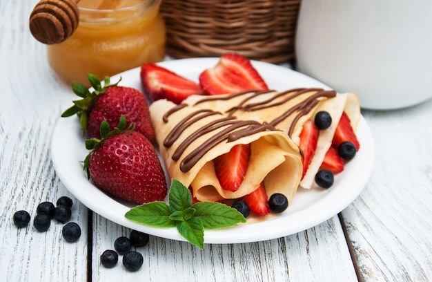 Crepes with strawberries and chocolate sauce