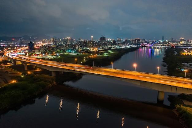 Crescent bridge - landmark of new taipei, taiwan with beautiful illumination at night