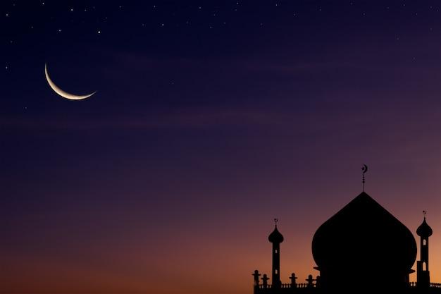 모스크 돔 위에 어두운 파란색 황혼 하늘에 초승달