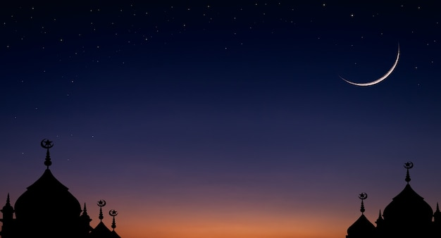 Crescent moon sky on dark blue dusk over dome mosque silhouette