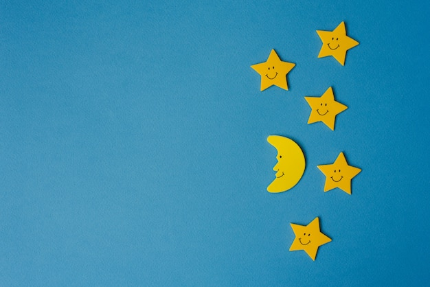 Crescent moon and yellow stars against the blue night sky. application paper.