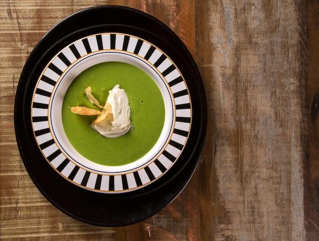 Cress soup with gorgonzola cheese and crispy potato
