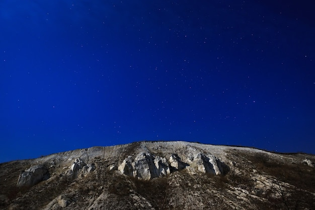 The cretaceous mountain on a background of the star sky.