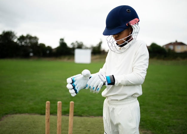 Cricket player getting ready to play