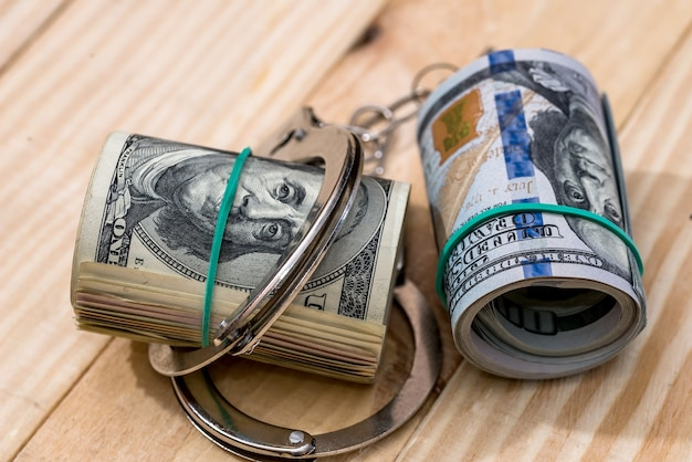 Criminal concept - handcuffs and dollar