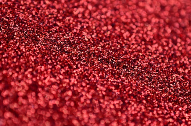 Crimson red decorative sequins. image with shiny bokeh lights from small elements