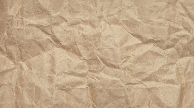 Crinkle crumpled kraft paper background with textured