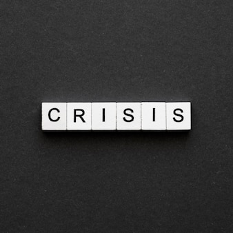 Crisis word written on wooden cubes