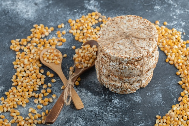 Crisp bread in rope with uncooked popcorn seeds.
