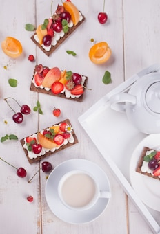 Crisp bread with creme cheese, fruit and berries