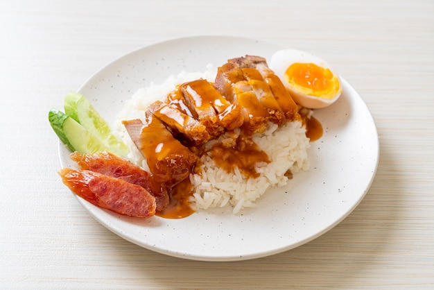 Crispy belly pork on rice with barbecue red sauce