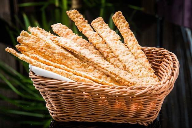 Crispy bread sticks on old wooden table.