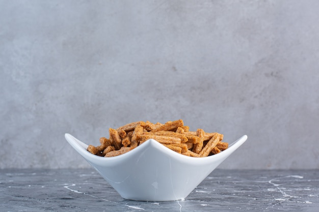 Crispy breadcrumbs in bowl , on the marble surface