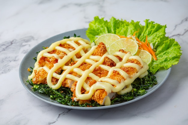 Crispy chicken with lemon cream, beautifully decorated.