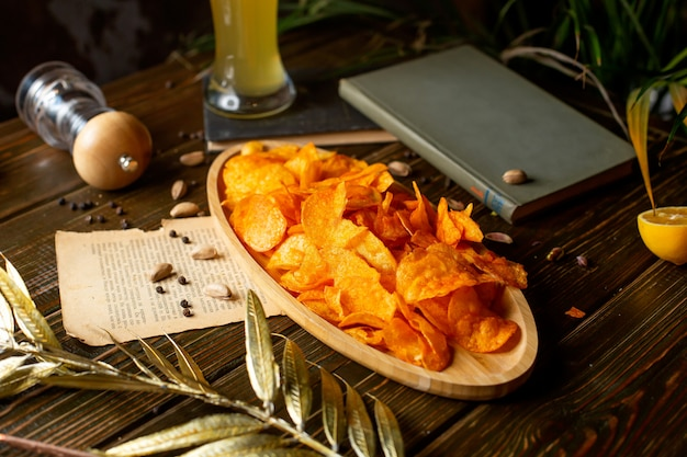 Crispy chips in a wooden bowl