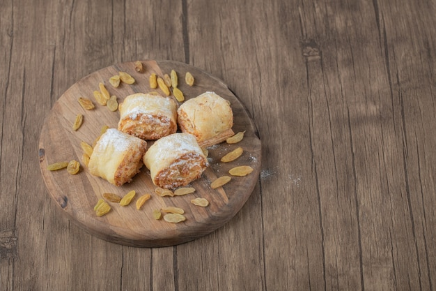 Crispy cooked roll cookies with stuffing on a wooden board.