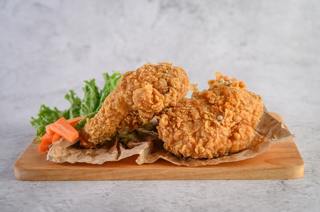 Crispy fried chicken on a wooden cutting board