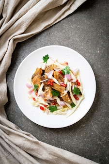 Crispy gourami fish with spicy salad