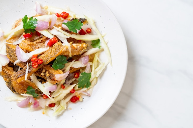 Crispy gourami fish with spicy salad