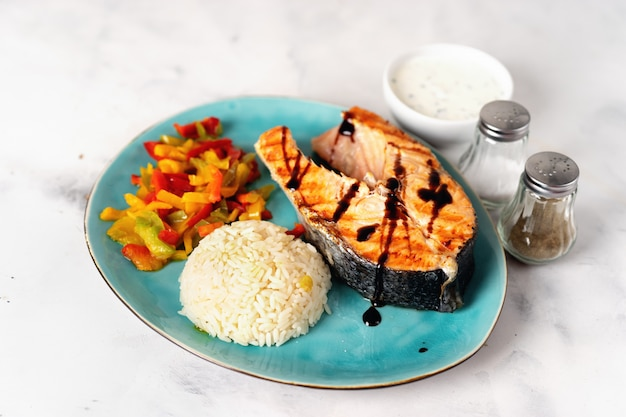 Crispy grilled salmon steak with steamed paprika and rice