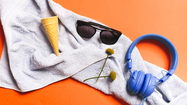 Crispy ice cream cones and summer accessories on towel