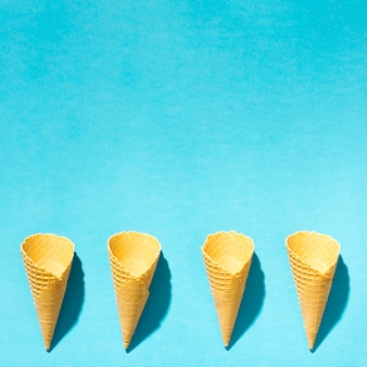 Crispy ice cream wafers horns on colorful background