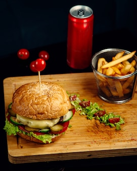 Crispy meat cheeseburger and french fries