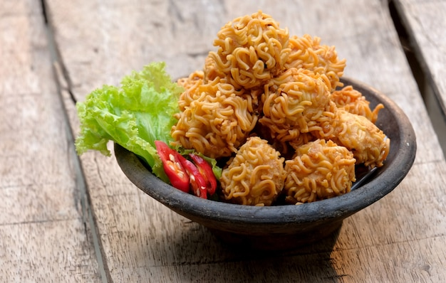 Crispy noodle balls served on bowl also known as bola bola mie