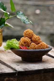 Crispy noodle balls served on bowl