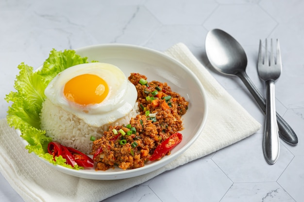 Crispy omelet topped with minced pork and mixed vegetables sauce