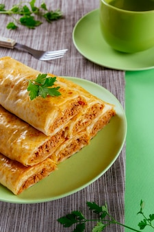 Crispy phyllo pastry rolls stuffed with tuna and a cup of tea