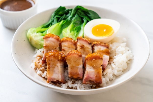 Crispy pork belly on topped rice