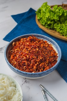 Crispy pork paste mixed with beautiful decorative ingredients, thai food.