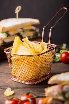 Crispy potato chips in copper basket