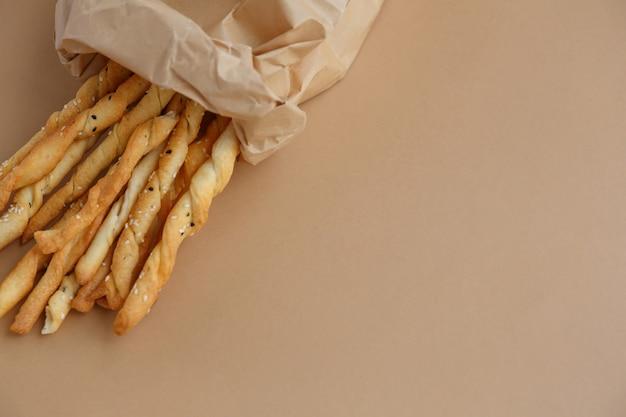 Crispy snack in a paper bag breadsticks for a quick bite