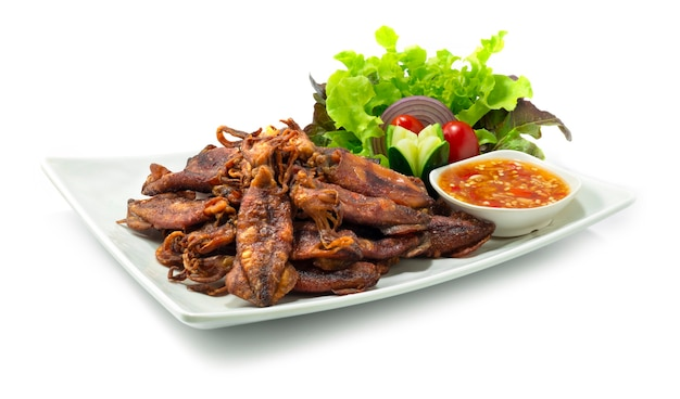 Crispy squids deep fried served spicy sauce thaifood style appetizer dish snack time decorate carved vegetables sideview