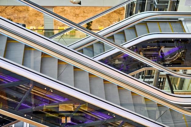 Crisscross escalators in shopping center