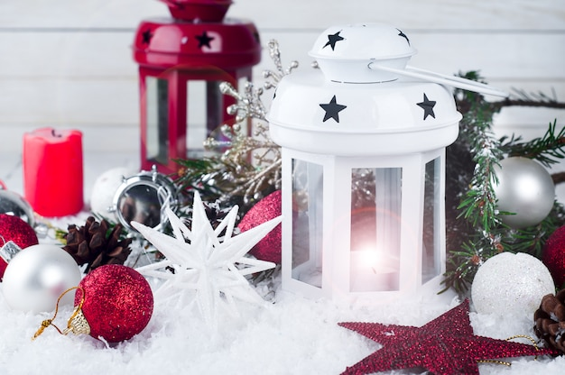 Cristmas lantern with decorations and snow