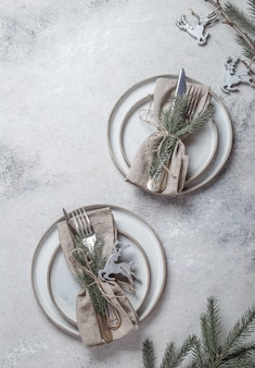 Cristmas table cutlery set with holiday decoration