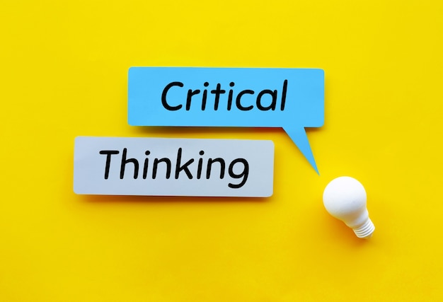 Critical thinking idea and creativity concepts with lightbulb and speech bubbles