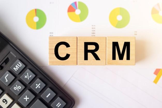 Crm acronym inscription on cubes. business concept.