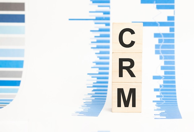 Crm sign on wooden cubes concept, wooden cubes.