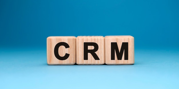 Crm word cube on a blue surface