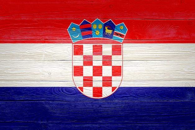 Croatia flag painted on old wood plank background