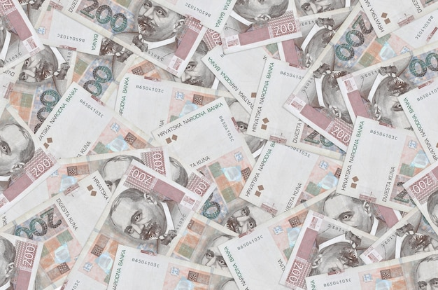 Croatian kuna bills lies in big pile. rich life conceptual background.