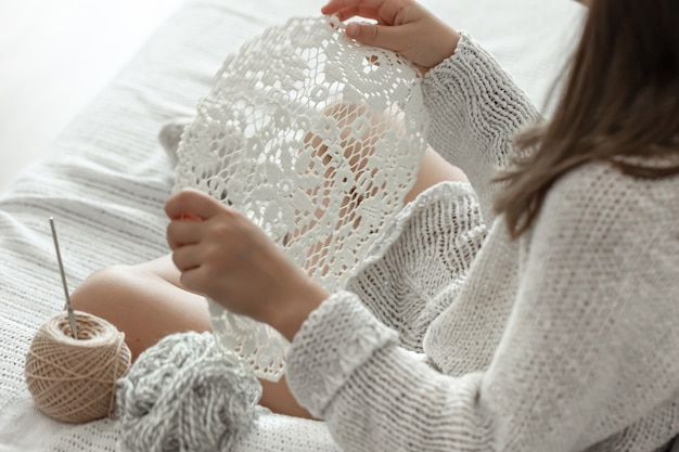 Crochet openwork napkin, handmade, home leisure and hobby concept.